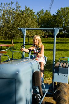 Free Farmer S Daughter On A Tractor Stock Photos - 2932273