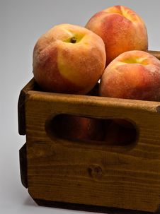 Peached In Wooden Crate Royalty Free Stock Images