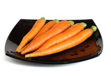 Free Fresh Carrots On A Black Dish Royalty Free Stock Photography - 2934077