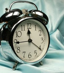 Free Alarm-clock On Blue Background Royalty Free Stock Photography - 2938457