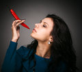 Free Woman Holding Red Hot Chili Pepper In Mouth Royalty Free Stock Photography - 29302107