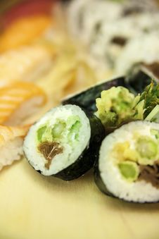 Free Futomaki Asparagus And Blurred Nigiri And California Roll Royalty Free Stock Photography - 29302057
