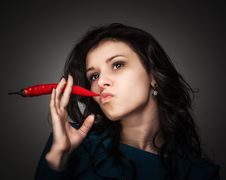 Free Woman Holding Red Hot Chili Pepper In Mouth Royalty Free Stock Images - 29302109
