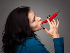 Free Woman Holding Red Hot Chili Pepper In Mouth Royalty Free Stock Photos - 29302118