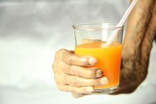 Free Senior Female Hand Holding A Glass Of Orange Juice Stock Photography - 29302402
