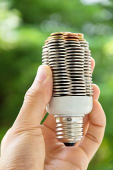 Free Hand Holding Coin Light Bulb Stock Image - 29311641