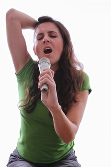 Female Singing Through A Microphone In Her Hand Stock Photography