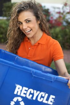 Free Pretty Woman Holding Recycle Bin Smiling Royalty Free Stock Image - 29350456