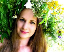 Free A Girl In A Wreath Of Flowers And Herbs Royalty Free Stock Photography - 29354707
