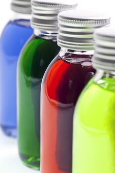 Bottles In A Row With Colored Liquid Stock Image