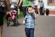 Free Little Boy Drinking From Plastic Bottle Royalty Free Stock Photo - 29377195
