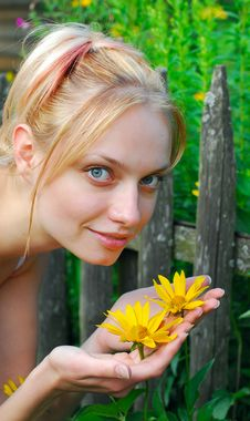 The Girl And Yellow Flowers Stock Image