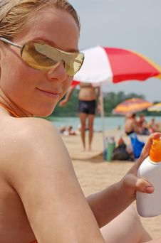 Free Woman Holding Sunscreen Royalty Free Stock Photo - 2947295
