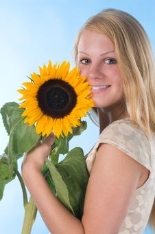 Free The Girl With A Sunflower Royalty Free Stock Photography - 2947467