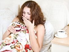 Free Beautiful Young Woman Lying In Bed With A Gift Stock Photo - 29417710