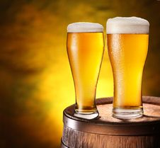 Free Two Glasses Of Beer On A Wooden Barrel. Stock Photography - 29419152