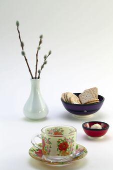 Tea Cup, Cookies, Chocolates And A Vase Stock Photos