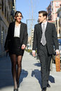 Free Attractive Business People Walking On The Street. Couple Working Stock Photography - 29445022
