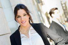 Attractive Businesswoman Standing Outside Of Company Building. C Royalty Free Stock Photography