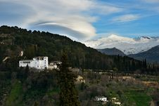 Free Alhambra And Snowing Sierra Nevada Mountains Under A Lenticular Royalty Free Stock Image - 29445306