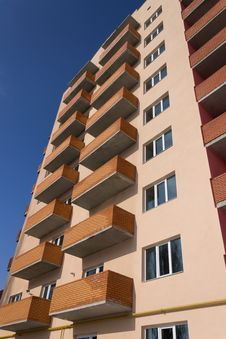 Free Apartment Building On A Blue Sky Royalty Free Stock Photos - 29455648