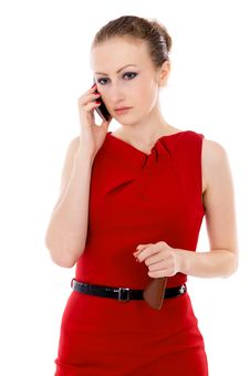 The Girl In The Red Dress Talking On The Phone Royalty Free Stock Photo