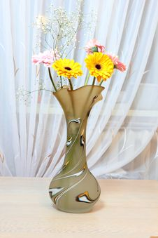 Yellow Flowers In A Beautiful Original Vase. Stock Images