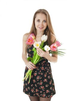 Portrait Of A Happy   Girl With A Bouquet Of Spring Tulips. Stock Photo