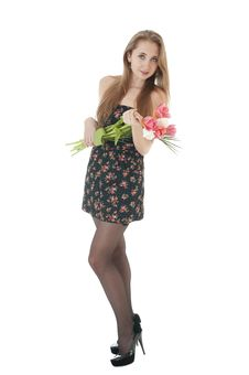 Portrait Of A Happy   Girl With A Bouquet Of Spring Tulips. Royalty Free Stock Photography