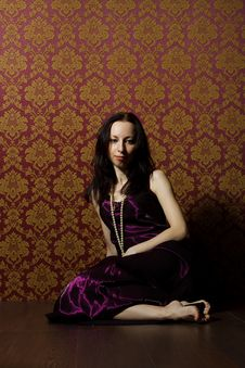 Pretty Young Woman In Vinous Dress Sitting On The Floor Stock Images