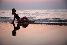 Young Woman Seats In Water Royalty Free Stock Image