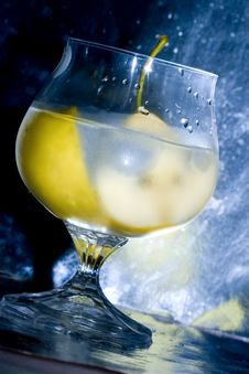 Pear In Glass With Martini Stock Photography