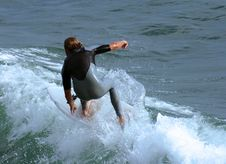 Surfer Catching A Wave Royalty Free Stock Photos