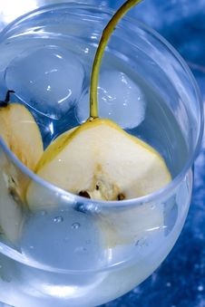 Pear In Glass With Martini Stock Photo