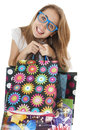 Free Crazy Funny Young Girl With Shopping Gift Bags Wearing Glasses. Royalty Free Stock Photo - 29502415