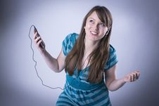 Student Woman Listening To Music Royalty Free Stock Images
