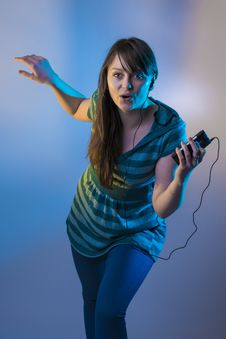 Free Cute Young Female Hearing Music From An Mp3 Player Stock Photo - 29501510