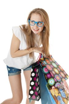 Free Crazy Funny Young Girl With Shopping Gift Bags Wearing Glasses. Stock Photos - 29502383