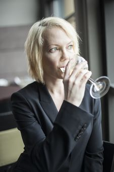 Free Blonde Woman With Beautiful Blue Eyes Drinking Glass Of White Wi Royalty Free Stock Photo - 29506385