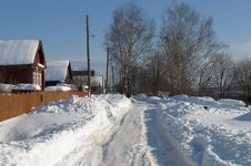 Snowy Road In The Village Royalty Free Stock Photos
