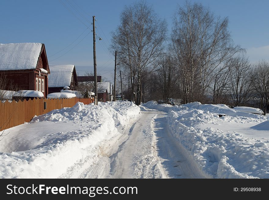 Snowy road in the village