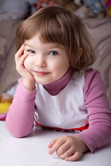 Free Girl Sitting At The Table Royalty Free Stock Photography - 29519217