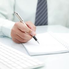 Businessman Signing A Document Stock Photos