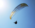 Free Silhouette Of Paraglider Against The Blue Sky Royalty Free Stock Image - 29535636