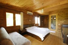 Wooden Hotel Bedroom Royalty Free Stock Photos