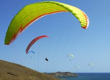 Free Few Paragliders Soar Over The Sea Shore Stock Photography - 29535642