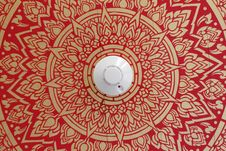 Smoke Detector On Art Pattern Ceiling Stock Photography