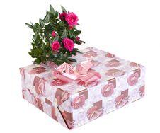 Box With A Gift And Bouquet Of Roses Royalty Free Stock Image