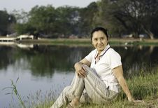 Free Portrait Of Smiling Woman Sitting On Green Field Royalty Free Stock Photography - 29547327