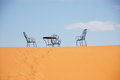 Free Wrought Iron Table And Chairs On The Top Of Sand Dune Stock Photography - 29550542